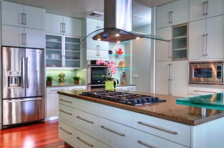contemporary island exhaust hood and simple white cabinet style