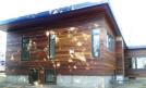 Cumaru siding using Climate Shield rain screen wood siding system resized 134