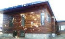 Cumaru siding using Climate Shield rain screen wood siding system resized 134