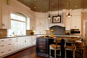 Custom painted kitchen cabinetry with stained island kitchen cabinets