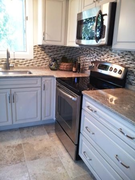 Full overlay cream painted kitchen cabinetry