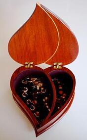 Paduak jewelry box with maple inlay open