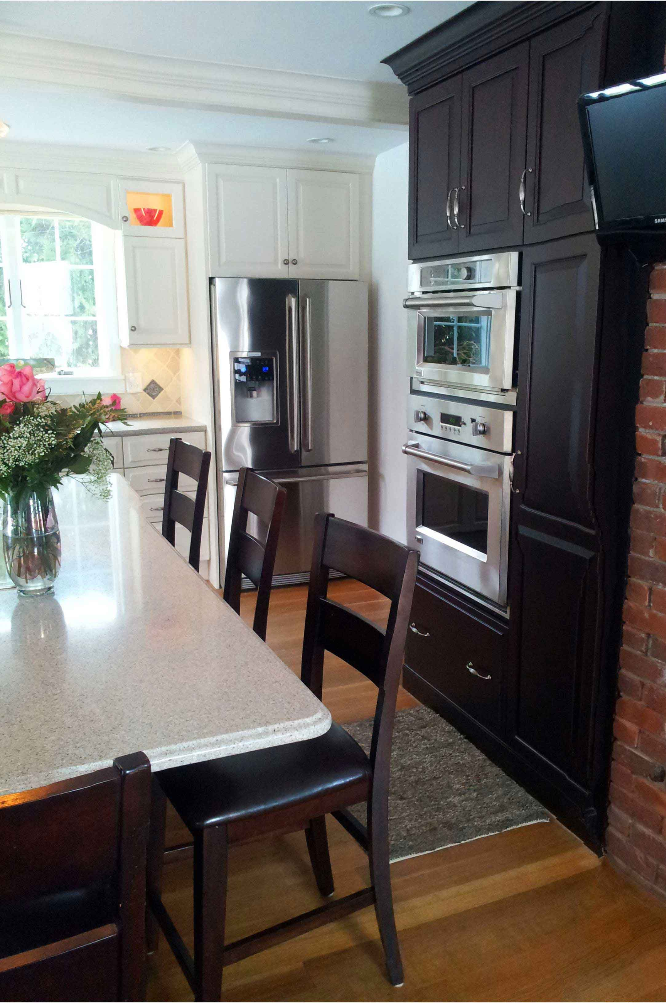 Beautiful dark stained cabinetry paired with classic white