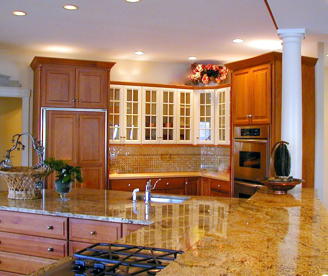 traditional kitchen with warm wood upper and lower cabinets