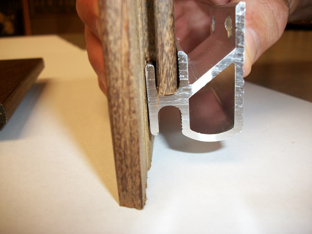 Climate-Shield rain screen clip fits into the notch at the bottom of siding board.jpg