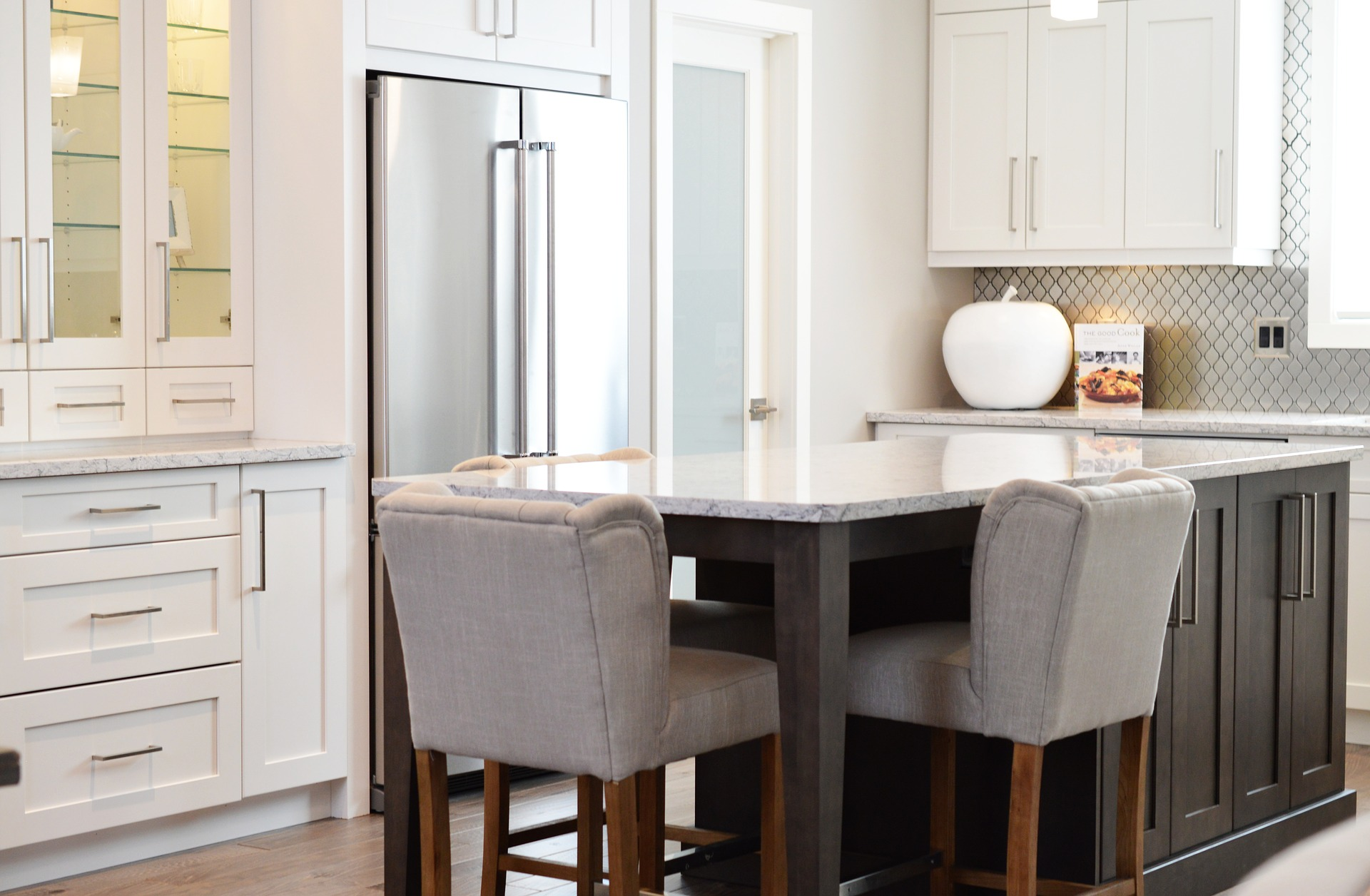 crisp white cabinetry and dark wood island are a beautiful combo