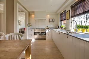 warm traditional kitchen with simple white cabinetry and minimal accents