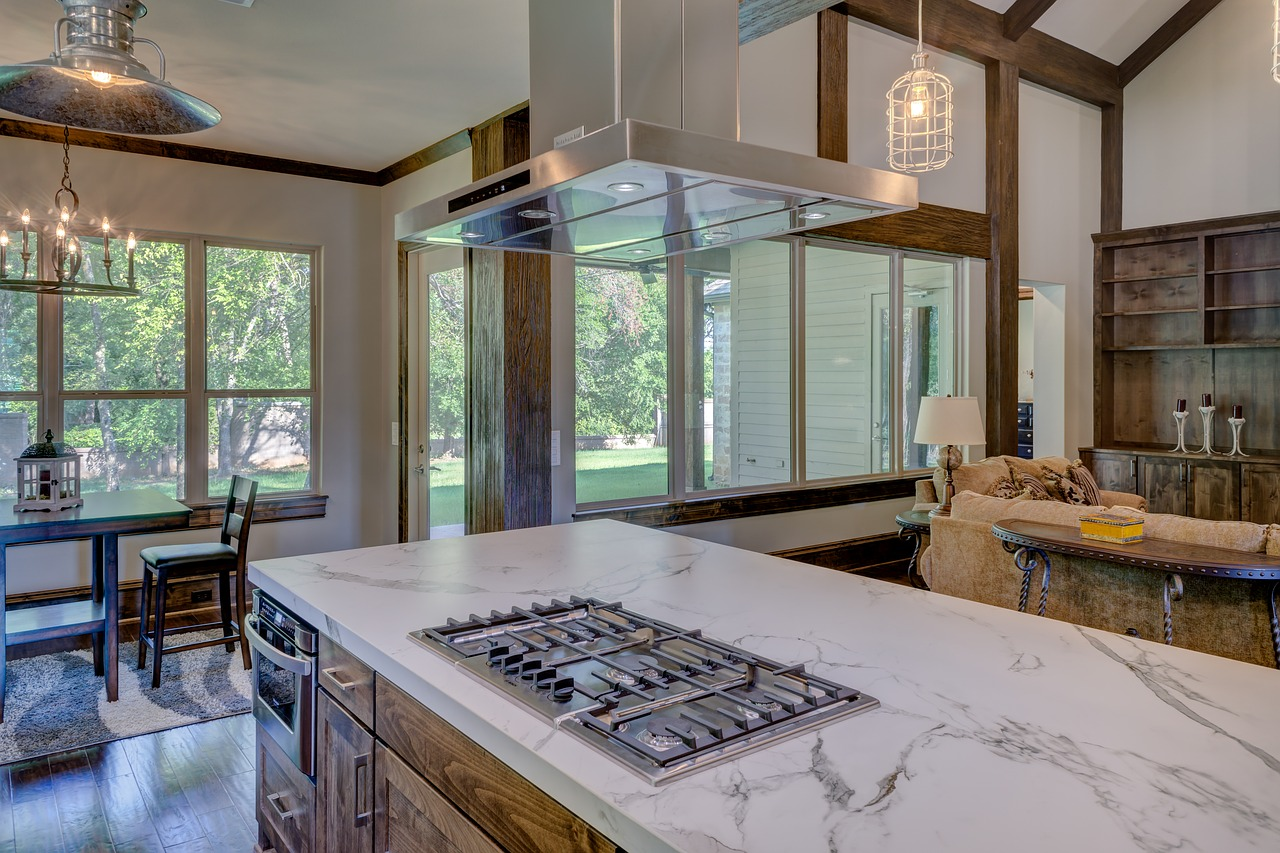 mission style kitchen with rustic lodge style lighting and modern appliances.jpg