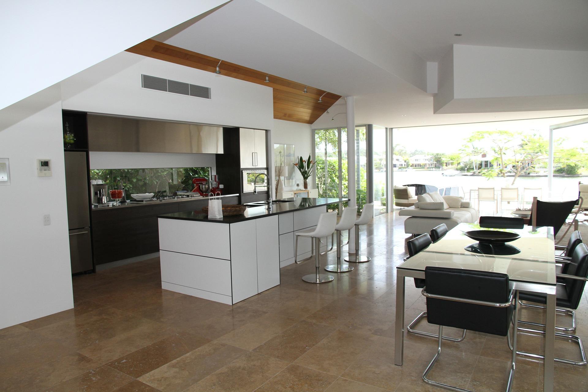 modern kitchen with white laminate cabinetry and black granite counter tops