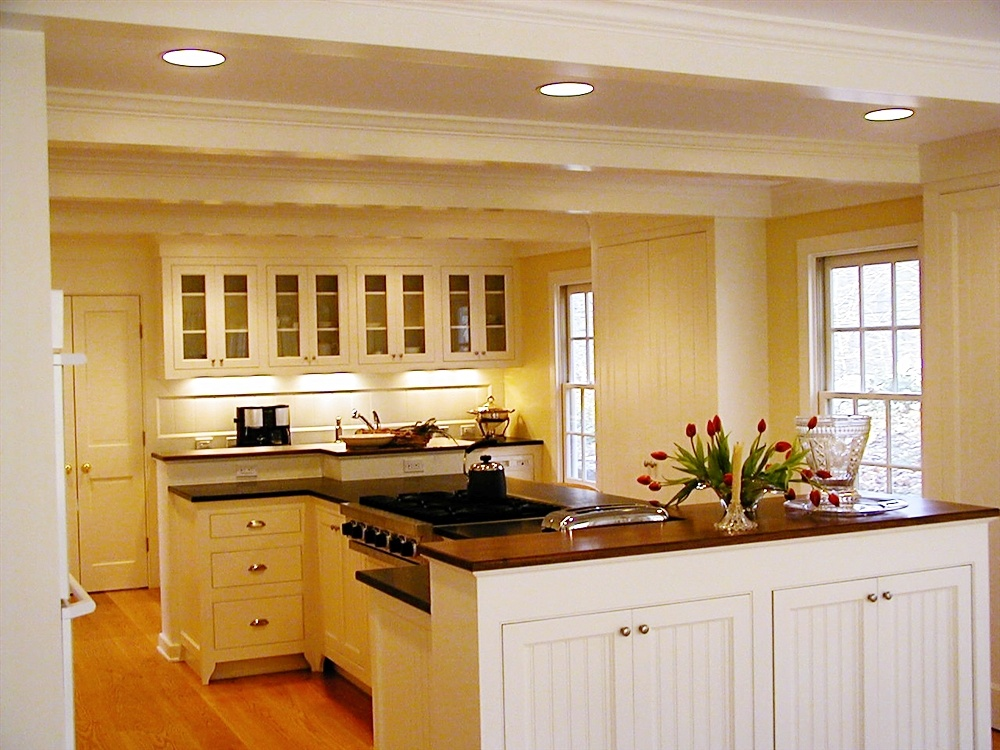 traditional_painted_cabinetry_with_inset_doors,_beadboard_panels_and_glass_wall_cabinets-828469-edited.jpg